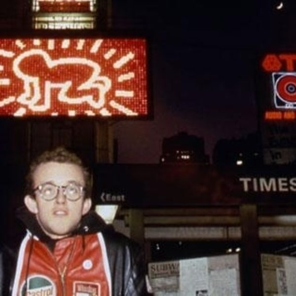 Keith Haring in front of Spectacolor Billboard, NYC